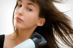 ways to get water out of your ear -blow dryer