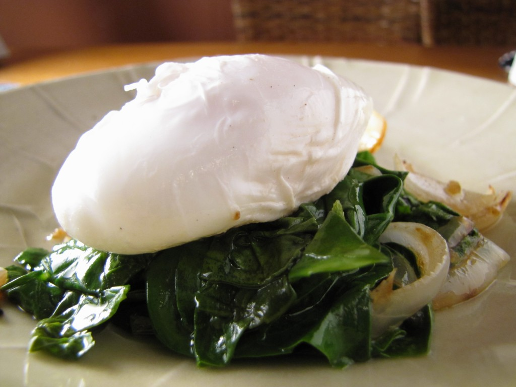 2 poached eggs over wilted spinach make a healthy breakfast.