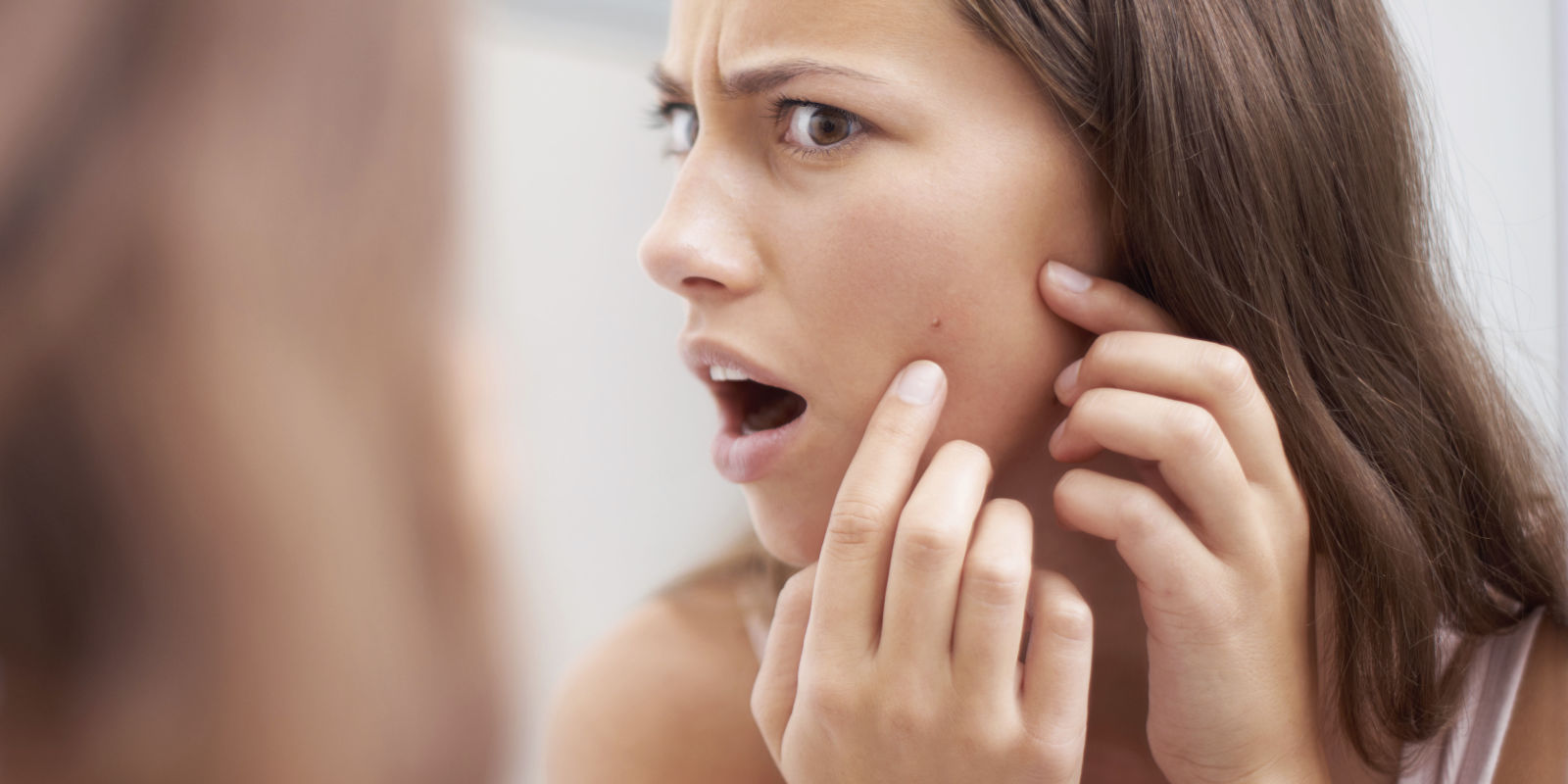 We all react like her when we get pimples or acne.